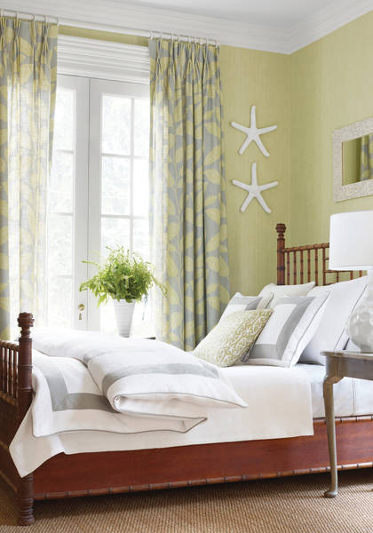 Designer fabric from Thibaut collection adds color to bedroom with custom drapery pillows and duvet