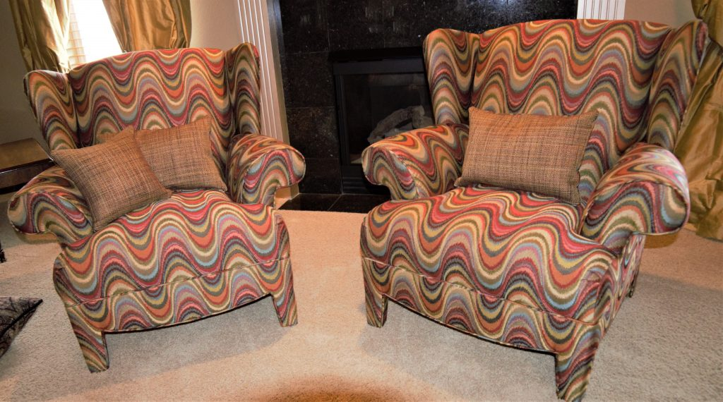 Side by side matching patterned upholstery chairs