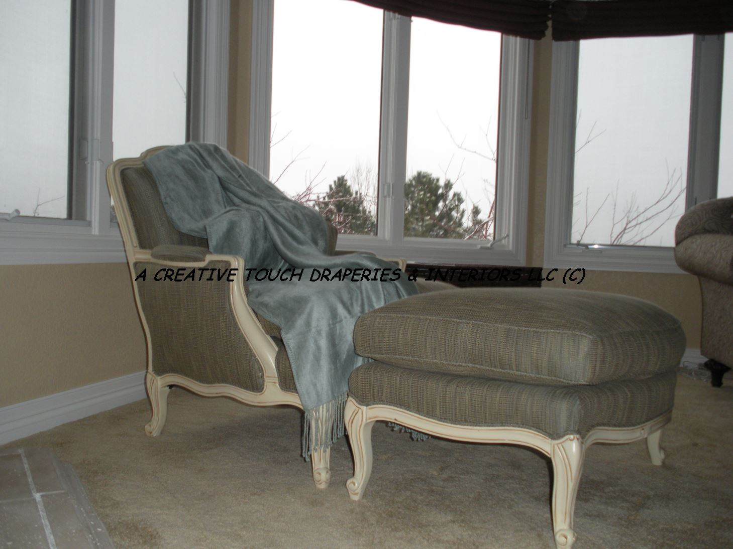 Chair and ottoman after upholstery updates
